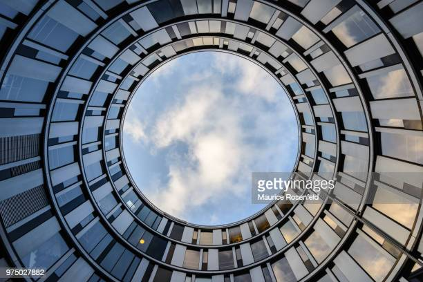 upward view from hamburger welle, hamburg, germany - circle stock pictures, royalty-free photos & images