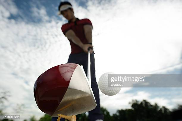 upward view of a golfer mid golf swing - golf swing stock pictures, royalty-free photos & images