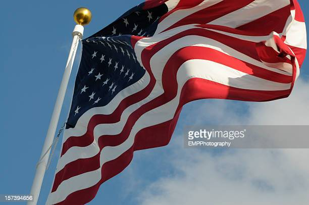 Upward View of American Flag on a White Pole