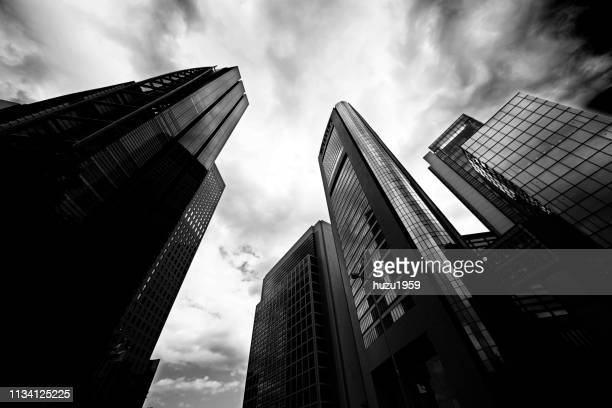 upward view of skyscrapers - 経済 stock pictures, royalty-free photos & images