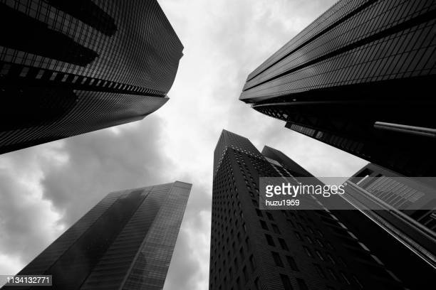 upward view of skyscrapers - 現代的 stock pictures, royalty-free photos & images