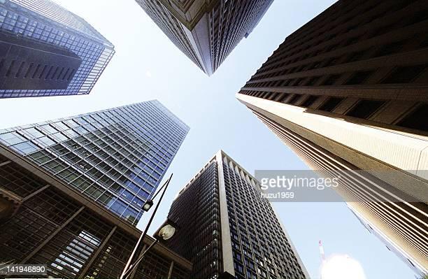 upward view of tokyo skyscrapers - 丸の内 ストックフォトと画像