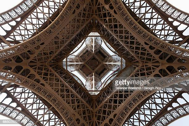 upwards view of eiffel tower - terence waeland stock pictures, royalty-free photos & images