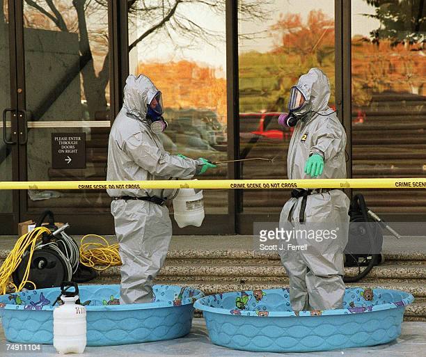 UPWorkers rinse off after exiting the Hart Senate Office Building which is closed for decontamination after an anthraxladen letter was opened in the...