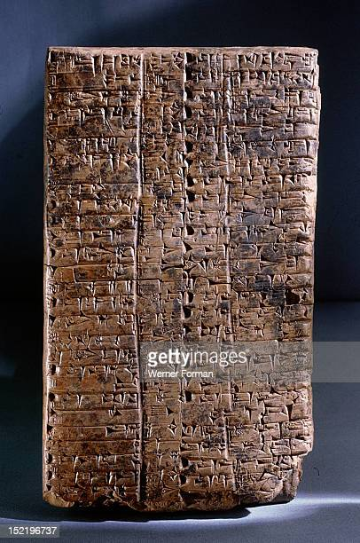 Ur III clay administrative tablet impressed with the scribes seal which depicts a goddess leading a worshipper and the text Ur Gigir scribe son of...