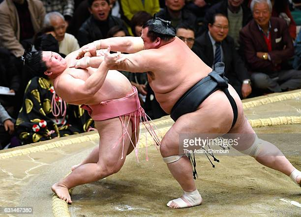 Ura holds the attack of Toyohibiki in the Juryo ranks during day four of the Grand Sumo New Year Tournament at Ryogoku Kokugikan on January 11 2017...