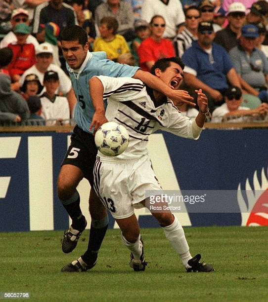 Uraguay's Carlos Jacques fouls New Zealand's Daniel Trent in the FIFA under 17 World Championship match at North harbour Stadium Albany Saturday...