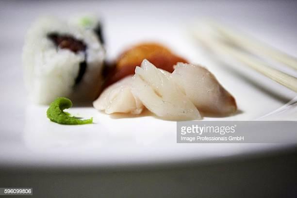 uramaki and nigiri sushi; sashimi and wasabi paste to the front - wasabi paste stock pictures, royalty-free photos & images