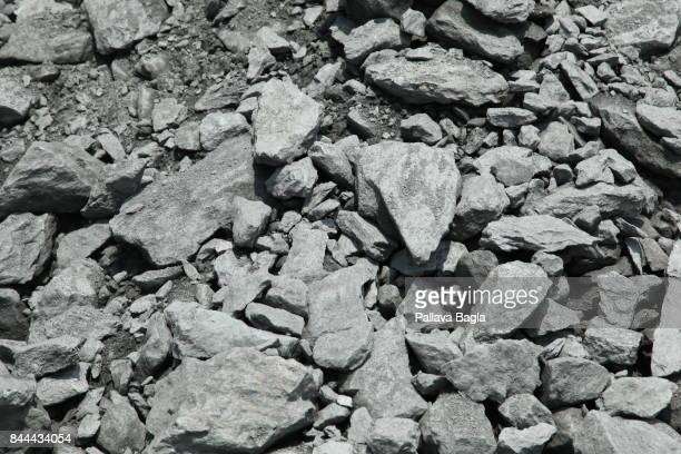 JADUGODA JHARKAHND INDIA SEPTEMBER 03 Uranium ore in rwa forms looks like a grayblack rock Uranium mining in India Inside Indias highly secure and...
