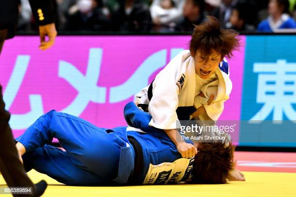 Urantsetseg Munkhbat of Mongolia and Ami Kondo of Japan compete in the Women's 48kg during day one of the Judo Grand Slam Tokyo at Tokyo Metropolitan...
