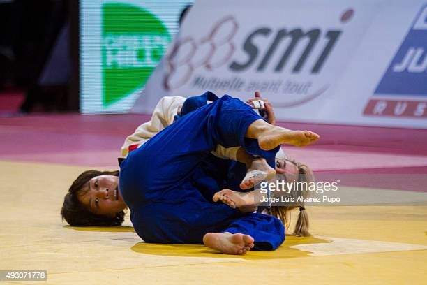 Urantsetseg Munkhbat of Mongolia competes against Charline Van Snick of Belgium during the -48kg Final of the Paris Grand Slam 2015 at the Palais...