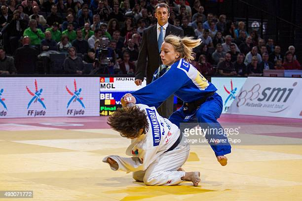 Urantsetseg Munkhbat of Mongolia is attacked by Charline Van Snick of Belgium during the -48kg Final of the Paris Grand Slam 2015 at the Palais...