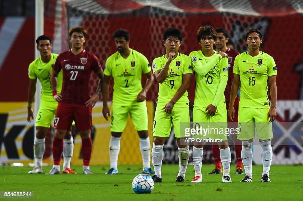 Urawa' players take position for free hit during the AFC Champions League semifinal football match between Shanghai SIPG FC and Urawa Red Diamonds in...