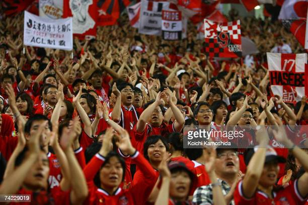 Urawa Red Diamonds fans celebrate during the Asian Champions League Group E match against Sydney FC at Saitama Stadium May 23 2007 in Saitama Japan