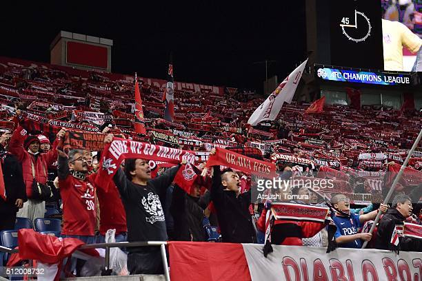 Urawa Red Diamonds fans cheer for their team during the AFC Champions League Group H match between Urawa Red Diamonds and Sydney FC at Saitama...
