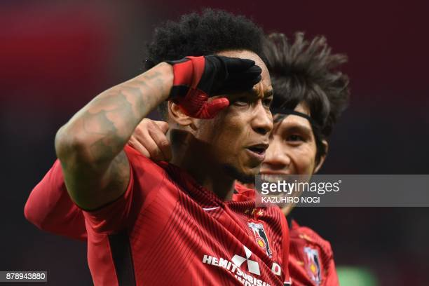 Urawa Red Diamonds' forward Rafael Da Silva celebrates scoring with midfielder Yosuke Kashiwagi during the second leg of the AFC Champions League...