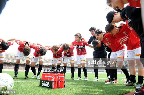 Urawa Red Diamonds Ladies players huddle prior to the Nadeshiko League match between Urawa Red Diamonds Ladies and Iga FC Kunoichi at the Urawa...