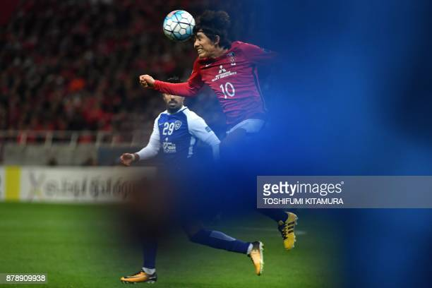 Urawa Red Diamonds' midfielder Yosuke Kashiwagi heads the ball past Al Hilal's midfielder Salem al-Dawsari during the second leg of the AFC Champions...
