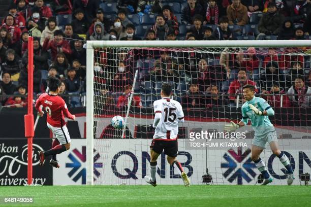 Urawa Red Diamonds' midfielder Yuki Muto scores a goal during the AFC Champions League group F football match between Japan's Urawa Red Diamonds and...