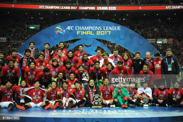 Urawa Red Diamonds players and staffs pose for photographs after the AFC Champions League Final second leg match between Urawa Red Diamonds and...