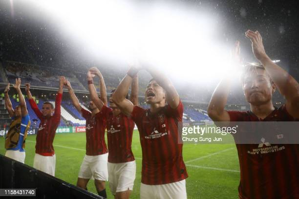 Urawa Red Diamonds players applaud away supporters after their 3-0 victory in the AFC Champions League round of 16 second leg match between Ulsan...