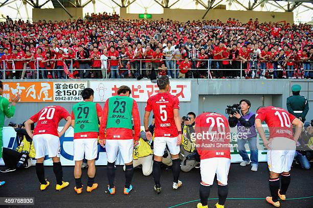 Urawa Red Diamonds players bow toward their supporters after the 11 draw in the JLeague match between Sagan Tosu and Urawa Red Diamonds at Best...