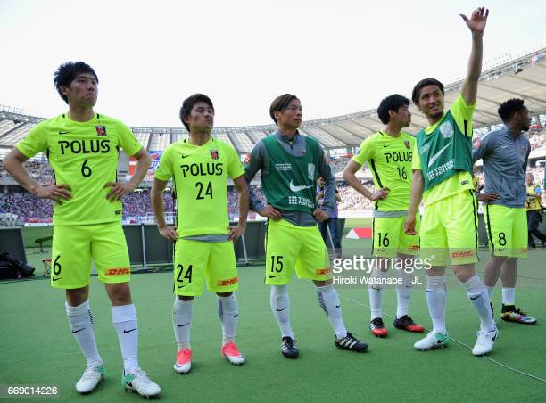 Urawa Red Diamonds players celebrate their 1-0 victory after the J.League J1 match between FC Tokyo and Urawa Red Diamonds at Ajinomoto Stadium on...