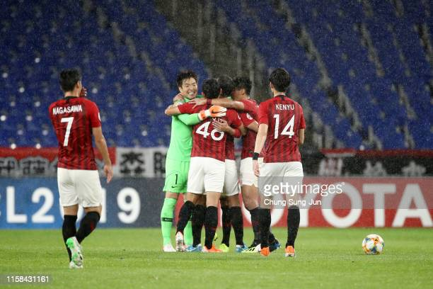 Urawa Red Diamonds players celebrate their 30 victory in the AFC Champions League round of 16 second leg match between Ulsan Hyundai and Urawa Red...
