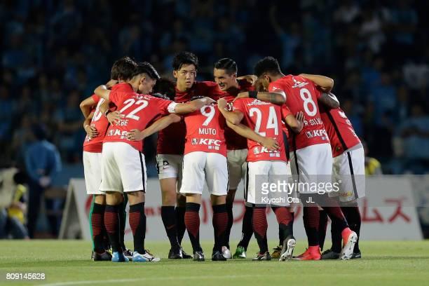Urawa Red Diamonds players huddle at the start of the second half during the JLeague J1 match between Kawasaki Frontale and Urawa Red Diamonds at...
