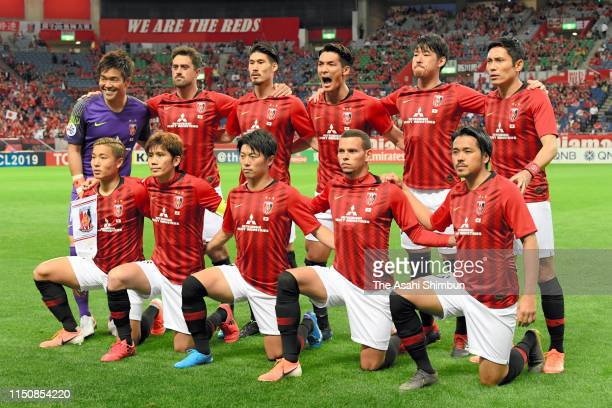 Urawa Red Diamonds players line up for the team photos prior to the AFC Champions League Group G match between Urawa Red Diamonds and Beijing Guoan...