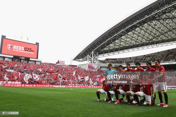 Urawa Red Diamonds players line up for the team photos prior to the JLeague J1 match between Urawa Red Diamonds and Consadole Sapporo at Saitama...