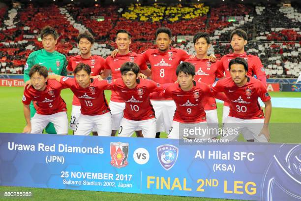 Urawa Red Diamonds players line up for the team photos prior to the AFC Champions League Final second leg match between Urawa Red Diamonds and...