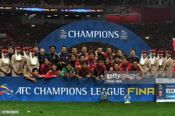 Urawa Red Diamonds players pose for photographs after the award ceremony after the AFC Champions League Final second leg match between Urawa Red...