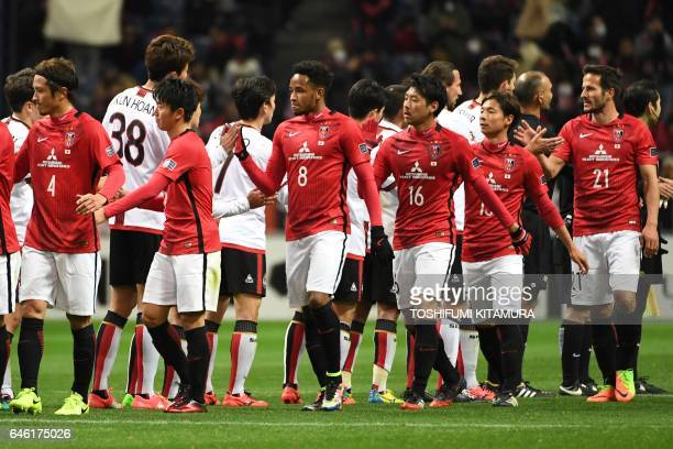 Urawa Red Diamonds' players shake hands with players from FC Seoul after their victory during the AFC Champions League group F football match between...