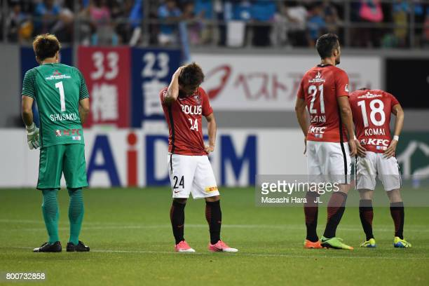 Urawa Red Diamonds players show dejection after the 1-2 defeat in the J.League J1 match between Sagan Tosu and Urawa Red Diamonds at Best Amenity...