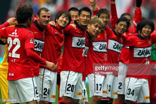 Urawa Red Diamonds players Yuki Abe Despotpvic Genki Haraguchi Tomoaki Makino Yosuke Kashiwagi Mitsuru Nagata Keita Suzuki and Naoki Yamada celebrate...