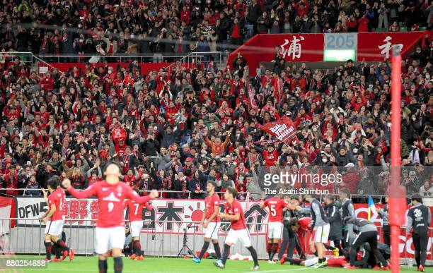 Urawa Red Diamonds supporters celebrate after winning the AFC Champions League Final second leg match between Urawa Red Diamonds and AlHilal at...