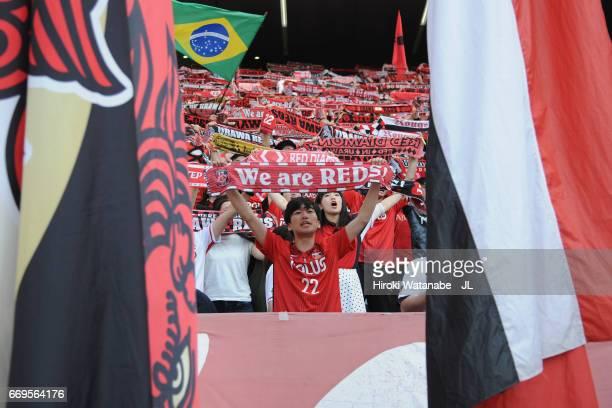 Urawa Red Diamonds supporters celebrate their 1-0 victory after the J.League J1 match between FC Tokyo and Urawa Red Diamonds at Ajinomoto Stadium on...