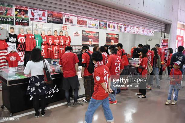 Urawa Red Diamonds supporters check an official marchandise shop prior to the JLeague J1 match between Urawa Red Diamonds and Kashima Antlers at...