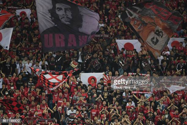 Urawa Red Diamonds supporters cheer after 11 draw in the JLeague J1 match between Urawa Red Diamonds and Vissel Kobe at Saitama Stadium on October 14...