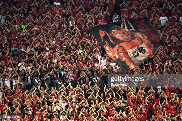 Urawa Red Diamonds supporters cheer after Albirex Niigata's first goal during the JLeague J1 match between Urawa Red Diamonds and Albirex Niigata at...
