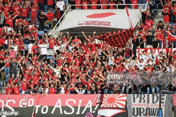 Urawa Red Diamonds supporters cheer during the JLeague J1 match between Vegalta Sendai and Urawa Red Diamonds at Yurtec Stadium Sendai on October 1...