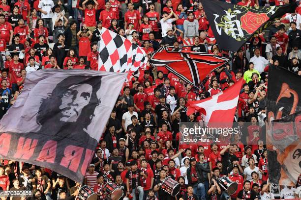 Urawa Red Diamonds supporters cheer during the JLeague J1 match between Kashima Antlers and Urawa Red Diamonds at Kashima Soccer Stadium on November...