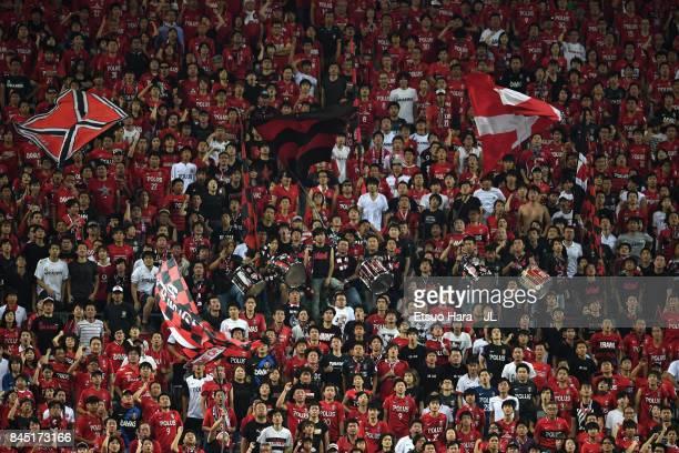 Urawa Red Diamonds supporters cheer during the JLeague J1 match between Urawa Red Diamonds and Kashiwa Reysol at Saitama Stadium on September 9 2017...