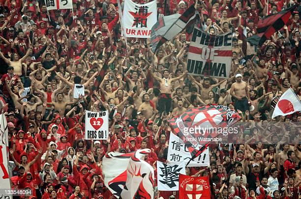 Urawa Red Diamonds supporters cheer during the JLeague match between Urawa Red Diamonds and Vegalta Sendai at Saitama Stadium on November 19 2011 in...