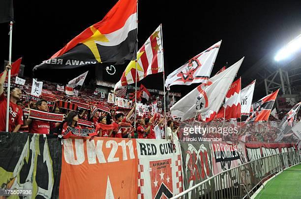 Urawa Red Diamonds supporters cheer during the JLeague match between Urawa Red Diamonds and Sanfrecce Hiroshima at Saitama Stadium on August 3 2013...