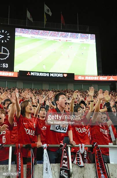Urawa Red Diamonds supporters cheer during the JLeague Yamazaki Nabisco Cup match between Urawa Red Diamonds and Omiya Ardija at Saitama Stadium on...