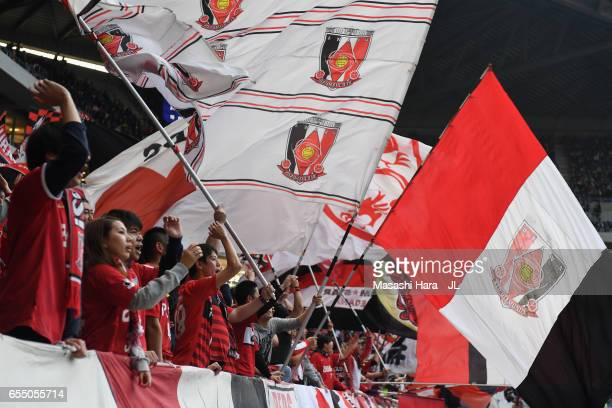 Urawa Red Diamonds supporters cheer prior to the JLeague J1 match between Gamba Osaka and Urawa Red Diamonds at Suita City Football Stadium on March...
