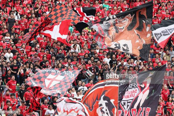 Urawa Red Diamonds supporters cheer prior to the JLeague J1 match between Urawa Red Diamonds and Consadole Sapporo at Saitama Stadium on April 22...