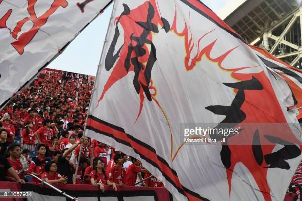 Urawa Red Diamonds supporters cheer prior to the JLeague J1 match between Urawa Red Diamonds and Albirex Niigata at Saitama Stadium on July 9 2017 in...